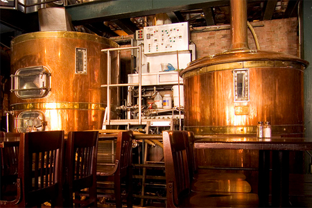 """New and old - craft beer brewing in commercial tanks"""